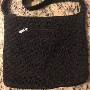 The SAK black crocheted purse